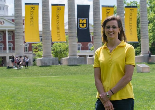 Paula Schuerer, biomedical sciences MS, stands on the Mizzou quad in front of the columns.