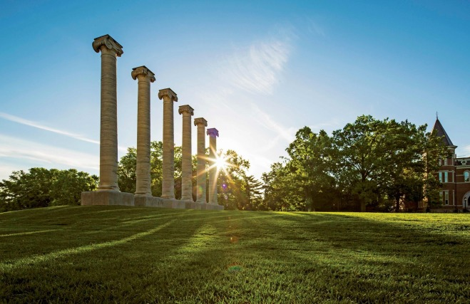The sun shining through the columns on the Quad on Mizzou's campus.