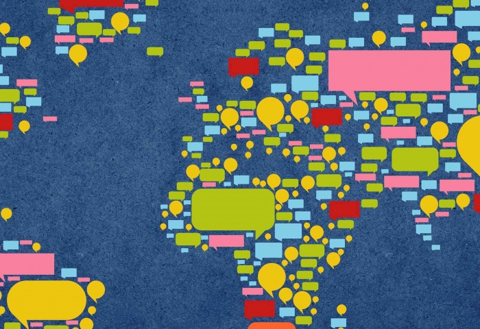 A map of the world made up of colorful speech bubbles.